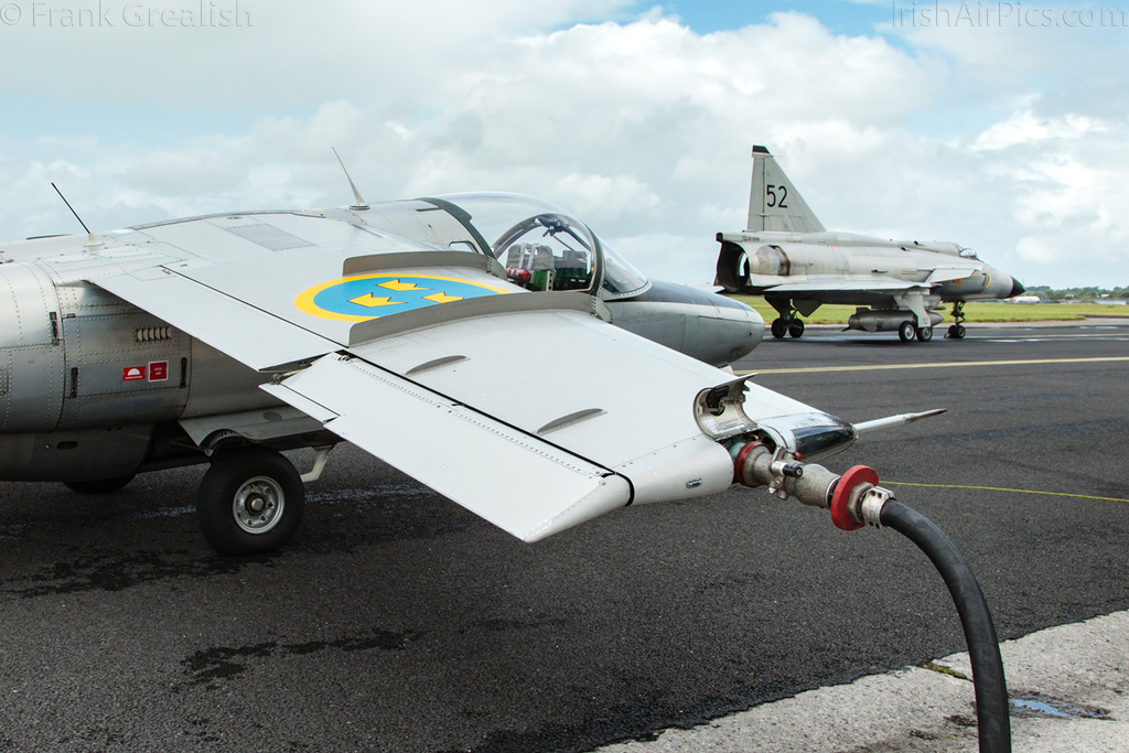 Saab Sk60 SE-DXG being refuelled prior to an air-to-air photoshoot with the Viggen visible in the background