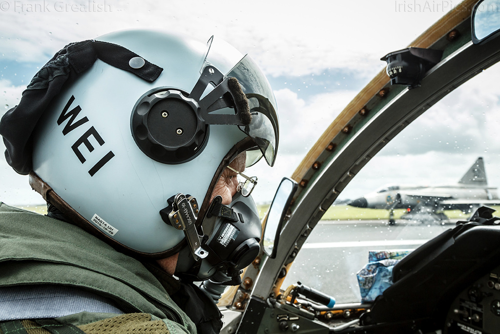 SwAFHF pilot Per Weilander prepares for an air-to-air photoshoot with the Viggen visible in the background