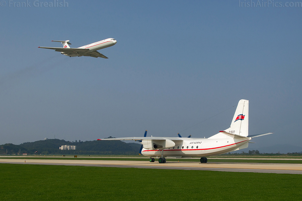 Air Koryo Antonov An-24 P-537 taxys for its display while Il-62 P-885 flies overhead