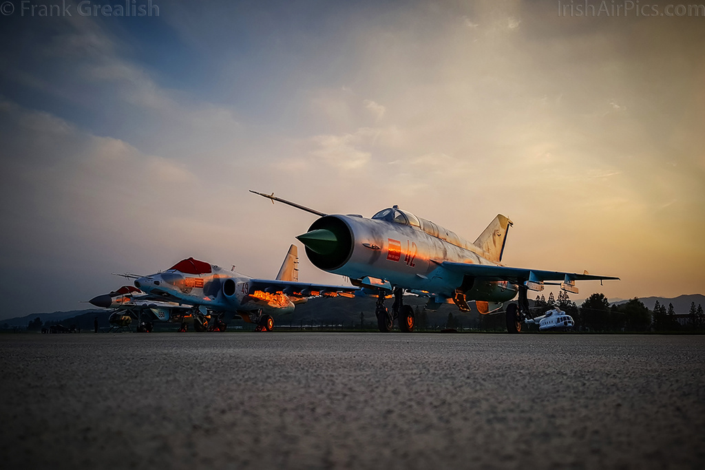KPAAF static display at sunset,  Mig-21,  Su-25,  Mig-29,  and MD-500