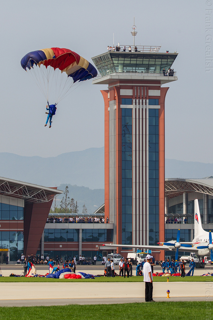Parachutist comes into land with Kalma tower in the background