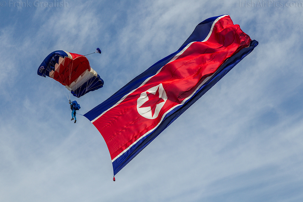 Pyongyang Air Club parachutist with the DPRK flag