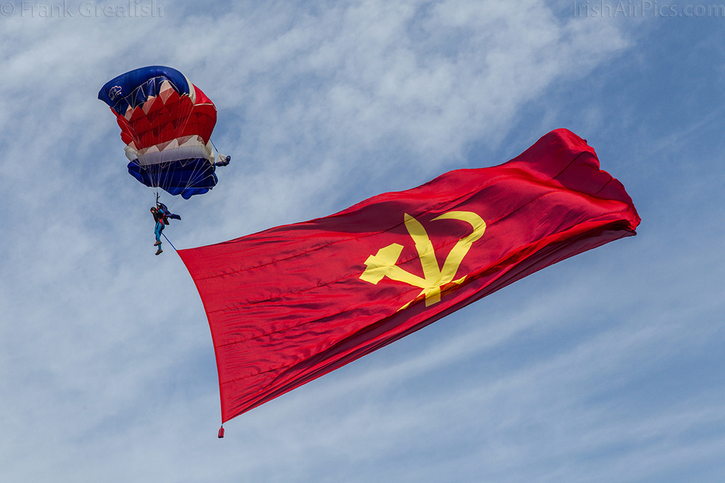 Pyongyang Air Club parachutist with the Korean Workers Party flag