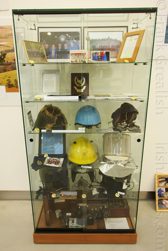 Display case with various artefacts and helmets