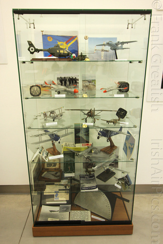 Display case with various artefacts and models
